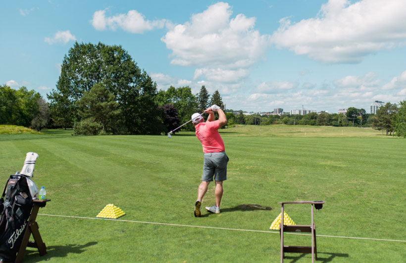 Golfer on course at learning center